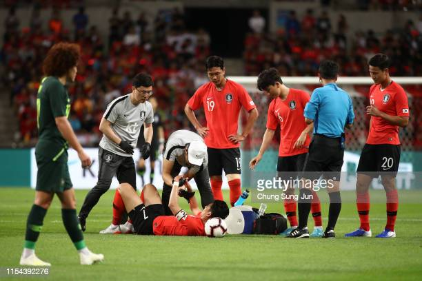 Son Heungmin lies injured during the international friendly match between South Korea and Australia at Busan Asiad Main Stadium on June 7 2019 in...