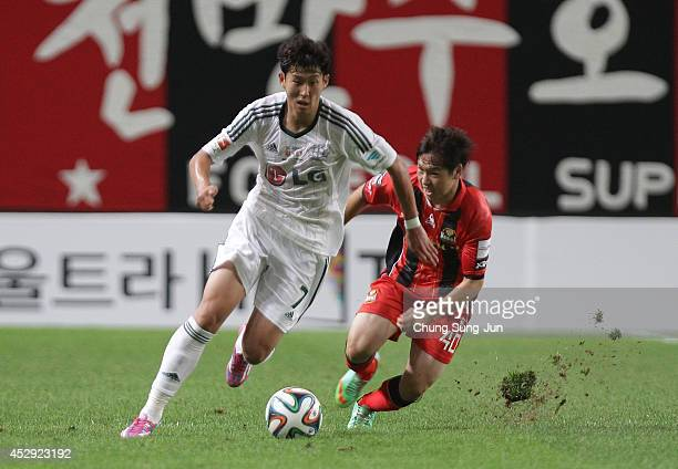 Son HeungMin of Bayer Leverkusen compete for the ball with Sin JeHyuck of FC Seoul during the match between Bayer Leverkusen and FC Seoul as a part...