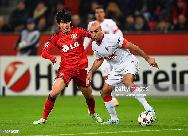Son HeungMin of Bayer Leverkusen marshalls Aymen Abdennour of Monaco during the UEFA Champions League group C match between Bayer 04 Leverkusen and...