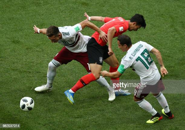Son HeungMin of Korea Republic is tackled by Hector Herrera and Andres Guardado of Mexico during the 2018 FIFA World Cup Russia group F match between...