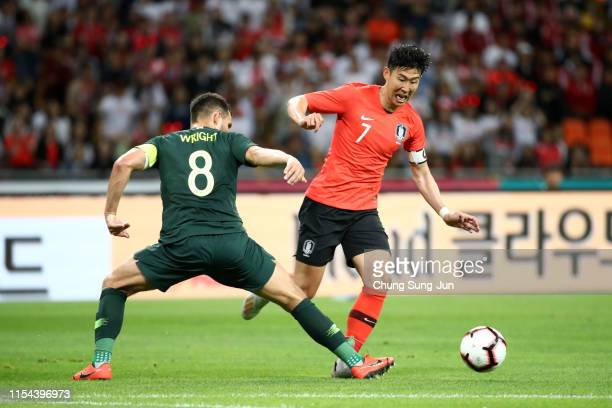 Son Heungmin of South Korea and Bailey Wright of Australia compete for the ball during the international friendly match between South Korea and...
