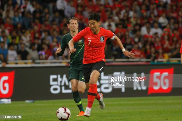 Son Heungmin of South Korea and Craig Goodwin of Australia action during an South Korea v Australia Friendly match at Asiad Stadium in Busan South...