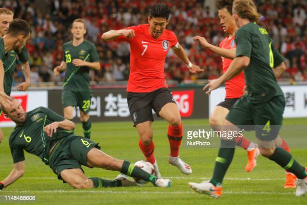 Son Heungmin of South Korea and Dimi Patratos of Australia action during an South Korea v Australia Friendly match at Asiad Stadium in Busan South...