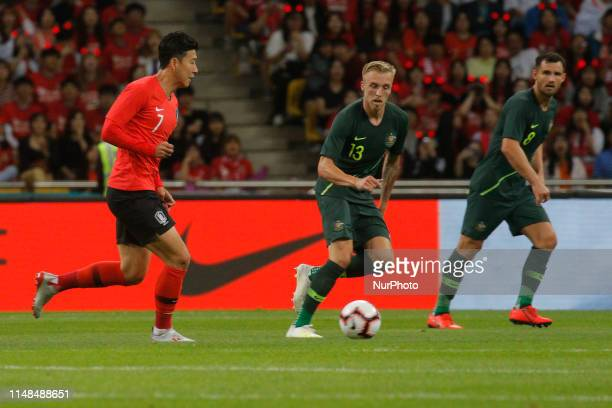 Son Heungmin of South Korea and James Jeggo of Australia action during an South Korea v Australia Friendly match at Asiad Stadium in Busan South...