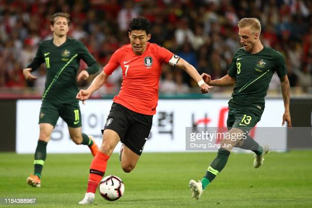 Son Heungmin of South Korea and James Jeggo of Australia compete for the ball during the international friendly match between South Korea and...