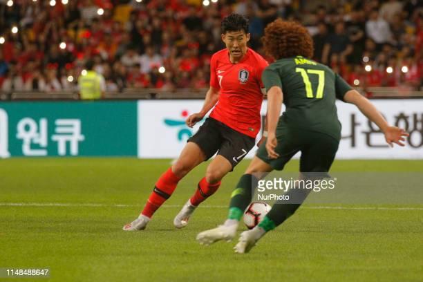 Son Heungmin of South Korea and Mustafa Amini of Australia action during an South Korea v Australia Friendly match at Asiad Stadium in Busan South...