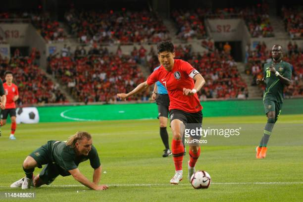 Son Heungmin of South Korea and Rhyan Grant of Australia action during an South Korea v Australia Friendly match at Asiad Stadium in Busan South...