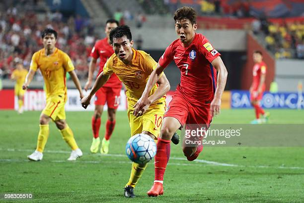 Son Heungmin of South Korea and Zheng Zhi of China compete for the ball during the 2018 FIFA World Cup Qualifier Final Round Group A match between...