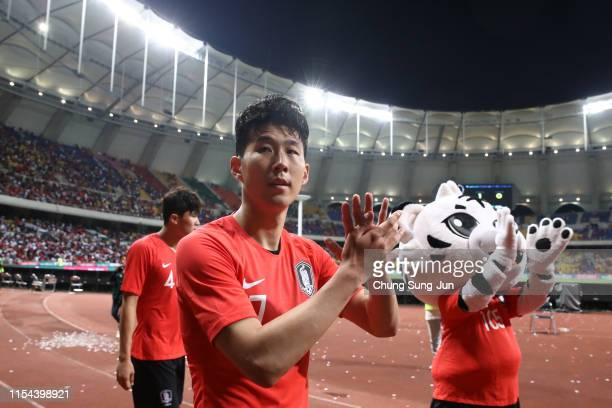 Son Heungmin of South Korea appaluds fans after his side's 10 victory in the international friendly match between South Korea and Australia at Busan...