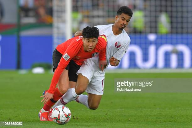 Son Heungmin of South Korea battles for possession with Akram Hassan Afif of Qatar during the AFC Asian Cup quarter final match between South Korea...