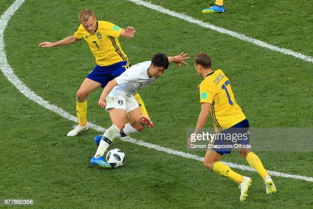 Son HeungMin of South Korea battles with Sebastian Larsson of Sweden and Viktor Claesson of Sweden during the 2018 FIFA World Cup Russia Group F...