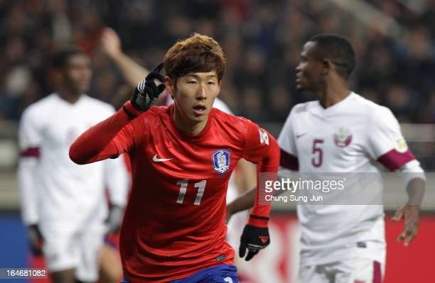 Son HeungMin of South Korea celebrates after scoring during the FIFA World Cup Qualifier match between South Korea and Qatar at Olympic Stadium on...