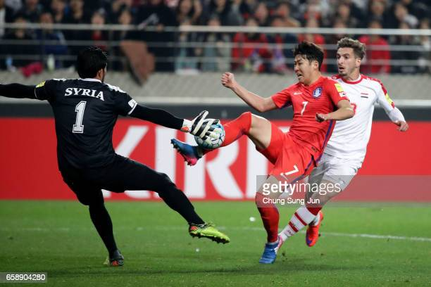 Son HeungMin of South Korea competes for the ball with Alma Ibrahim of Syria during the FIFA World Cup Qualification AFC Final Group Stage match...