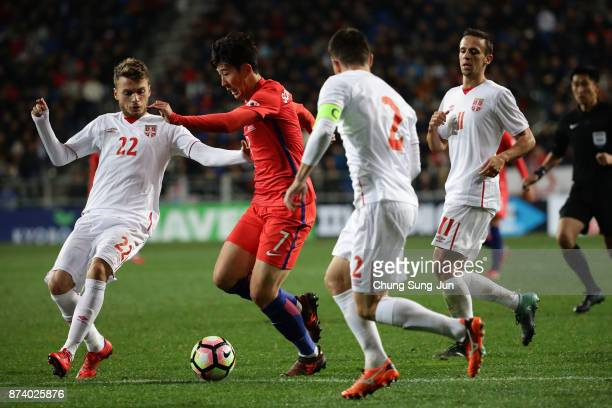 Son HeungMin of South Korea competes for the ball with Antonio Rukavina of Serbia during the international friendly match between South Korea and...