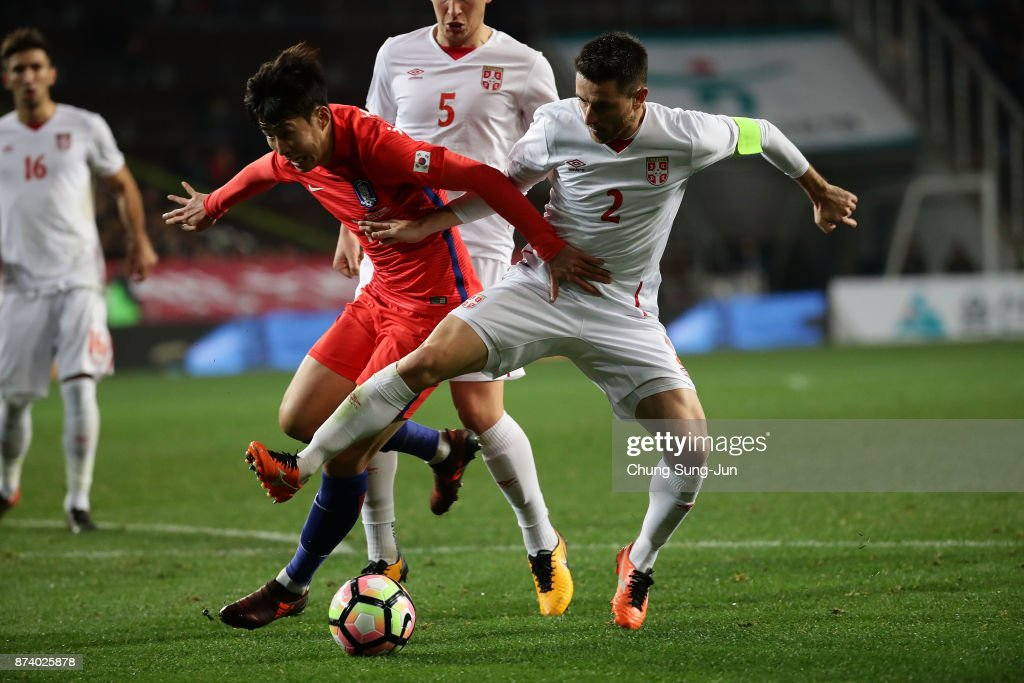 Son Heung-Min of South Korea competes for the ball with Antonio Rukavina of Serbia during the international friendly match between South Korea and Serbia at Ulsan World Cup Stadium on November 14, 2017 in Ulsan, South Korea.