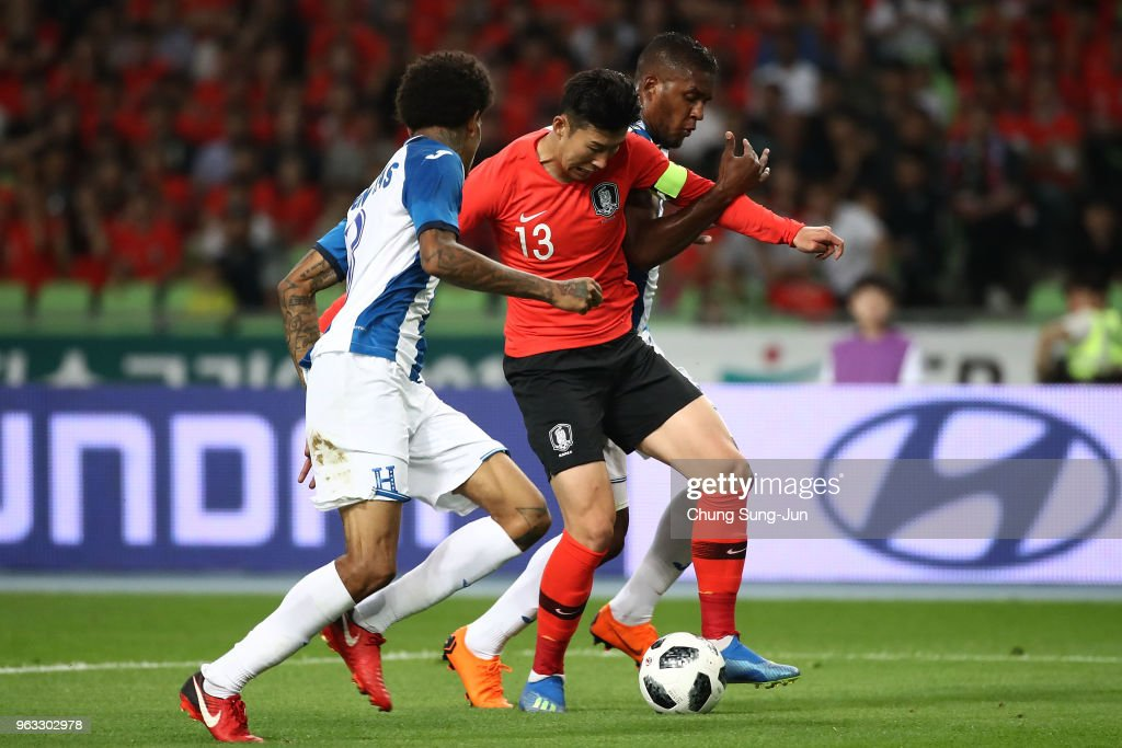 Son Heung-Min of South Korea competes for the ball with Brayan Beckeles of Honduras during the international friendly match between South Korea and Honduras at Daegu World Cup Stadium on May 28, 2018 in Daegu, South Korea.
