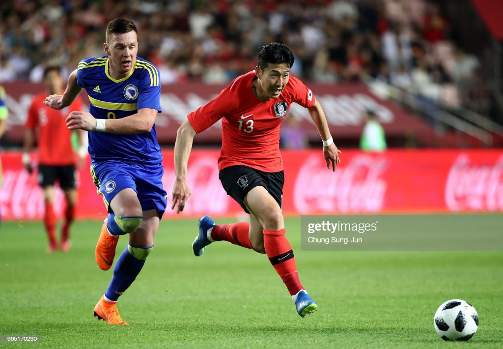 Son Heung-Min of South Korea competes for the ball with Haris Duljevic of Bosnia & Herzegovina during the international friendly match between South Korea and Bosnia & Herzegovina at Jeonju World Cup Stadium on June 1, 2018 in Jeonju, South Korea.