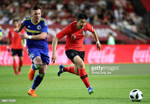 Son HeungMin of South Korea competes for the ball with Haris Duljevic of Bosnia Herzegovina during the international friendly match between South...