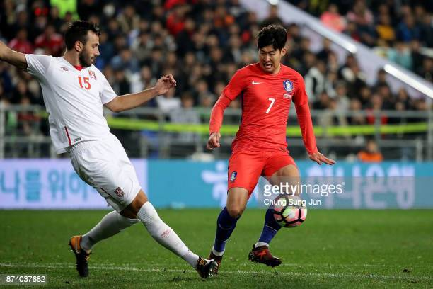 Son HeungMin of South Korea competes for the ball with Jagos Vukovic of Serbia during the international friendly match between South Korea and Serbia...