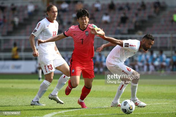 Son Heung-Min of South Korea competes for the ball with Joan Oumari of Lebanon during the FIFA World Cup Asian Qualifier 2nd round Group H match...