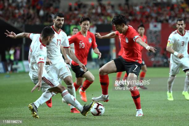 Son HeungMin of South Korea competes for the ball with Milad Mohammadi of Iran during the international friendly match between South Korea and Iran...