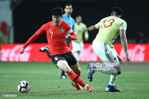 Son Heungmin of South Korea competes for the ball with Yerry Mina of Colombia during the International Friendly match between South Korea v Colombia...
