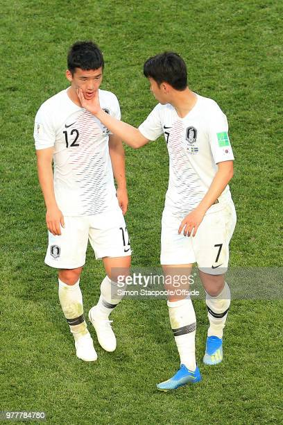 Son HeungMin of South Korea consoles Kim MinWoo of South Korea after his foul gave away the winning penalty during the 2018 FIFA World Cup Russia...