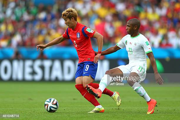 Son HeungMin of South Korea controls the ball as Yacine Brahimi of Algeria gives chase during the 2014 FIFA World Cup Brazil Group H match between...