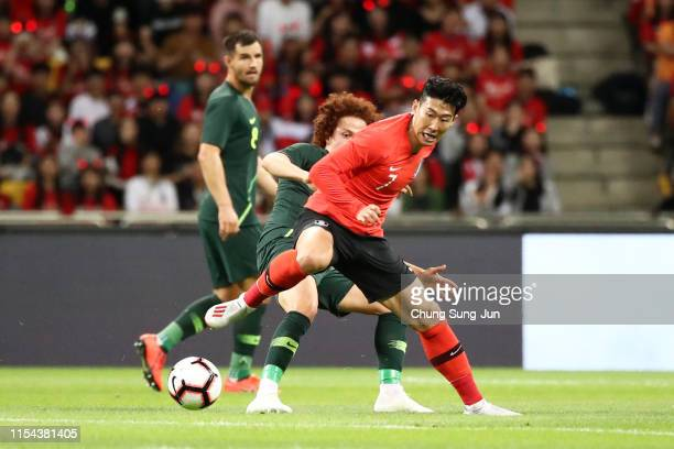 Son Heungmin of South Korea controls the ball under pressure of Mustafa Amini of Australia during the international friendly match between South...