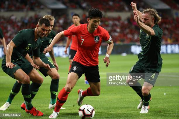 Son Heungmin of South Korea controls the ball under pressure of Australia defense during the international friendly match between South Korea and...