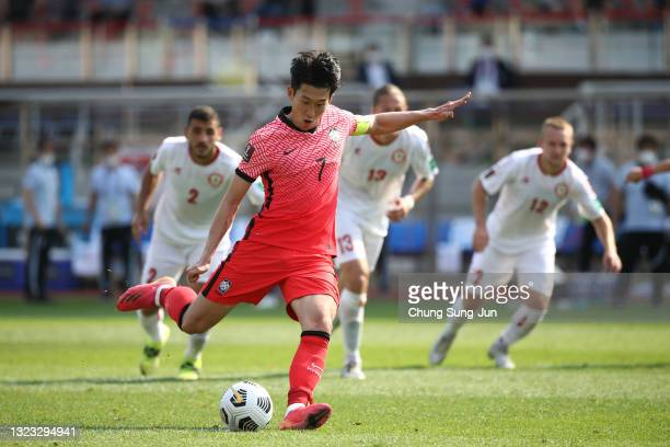 Son Heung-Min of South Korea kicks a penalty to score the team's second goal during the FIFA World Cup Asian Qualifier 2nd round Group H match...
