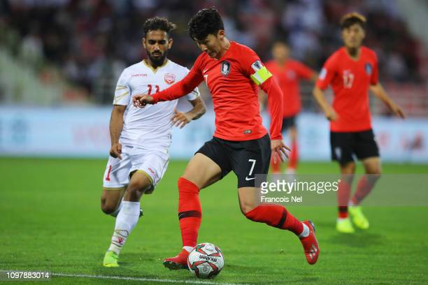 Son HeungMin of South Korea takes on Ali Madan of Bahrain during the AFC Asian Cup round of 16 match between South Korea and Bahrain at Rashid...