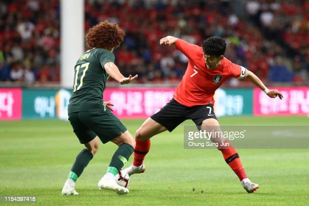 Son Heungmin of South Korea takes on Mustafa Amini of Australia during the international friendly match between South Korea and Australia at Busan...