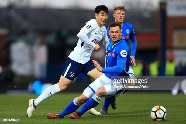 Son HeungMin of Spurs battles with Harrison McGahey of Rochdale and Andy Cannon of Rochdale during The Emirates FA Cup Fifth Round match between...