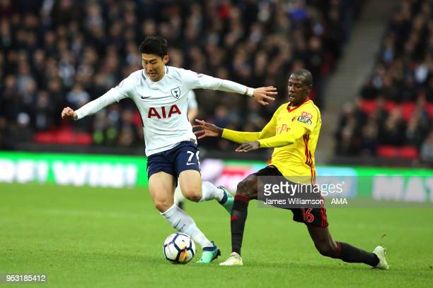 Son Heungmin of Tottenham and Jerome Sinclair of Watford during the Premier League match between Tottenham Hotspur and Watford at Wembley Stadium on...