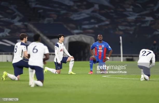 Son Heung-Min of Tottenham Hotspur alongside Christian Benteke of Crystal Palace as players take the knee before kick off of the Premier League match...
