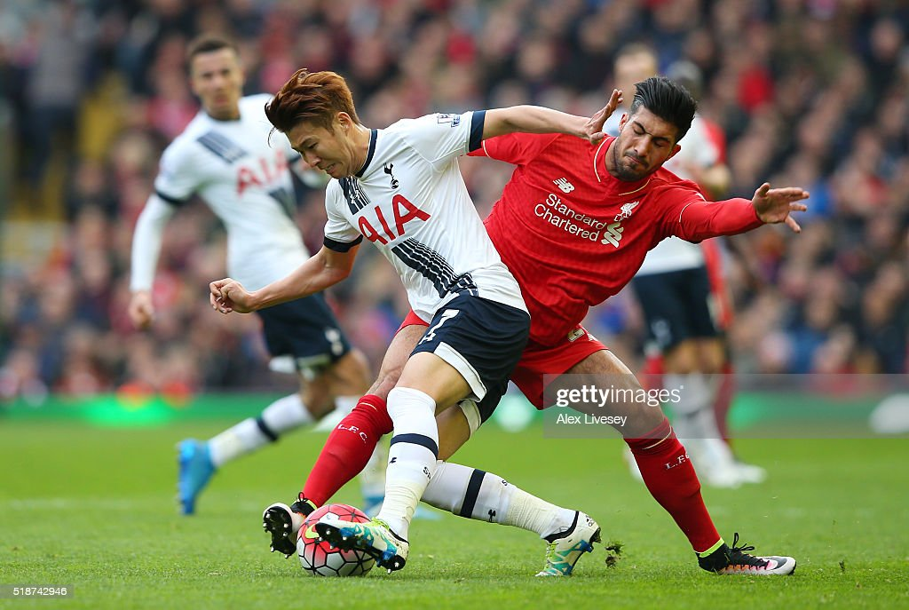 Son Heung-min of Tottenham Hotspur and Emre Can of Liverpool compete for the ball during the Barclays Premier League match between Liverpool and Tottenham Hotspur at Anfield on April 2, 2016 in Liverpool, England.