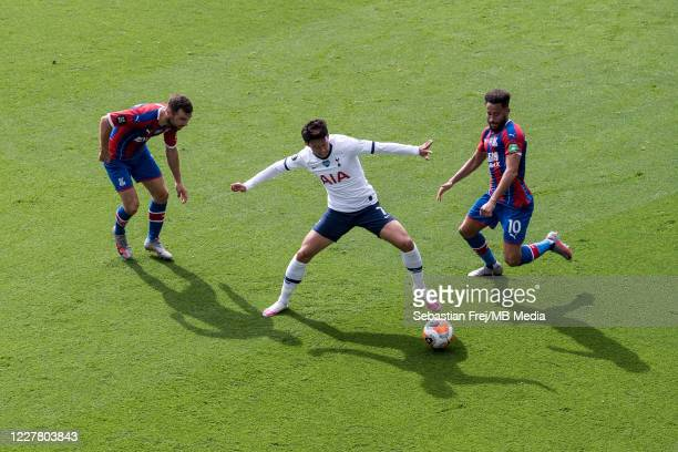 Son Heungmin of Tottenham Hotspur and James McArthur and Andros Townsend of Crystal Palace in action during the Premier League match between Crystal...