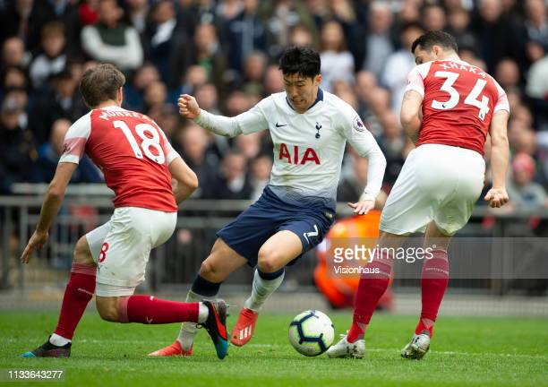 Son Heungmin of Tottenham Hotspur and Nacho Monreal and Granit Xhaka of Arsenal during the Premier League match between Tottenham Hotspur and Arsenal...