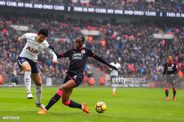 Son HeungMin of Tottenham Hotspur and Terence Kongolo of Huddersfield Town during the Premier League match between Tottenham Hotspur and Huddersfield...