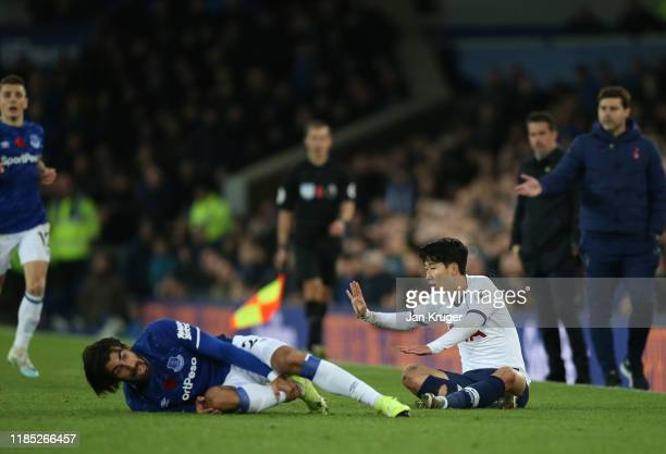 Son HeungMin of Tottenham Hotspur apologises after a tackle on Andre Gomes of Everton during the Premier League match between Everton FC and...