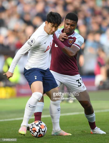 Son Heung-Min of Tottenham Hotspur battles for possession with Ben Johnson of West Ham United during the Premier League match between West Ham United...