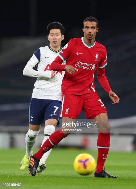Son Heung-Min of Tottenham Hotspur battles for possession with Joel Matip of Liverpool during the Premier League match between Tottenham Hotspur and...
