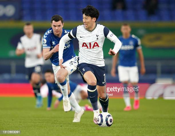 Son Heung-Min of Tottenham Hotspur battles for possession with Michael Keane of Everton during the Premier League match between Everton and Tottenham...