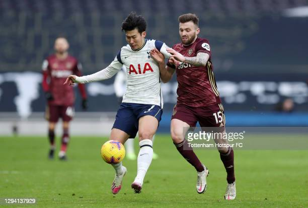 Son Heung-Min of Tottenham Hotspur battles for possession with Stuart Dallas of Leeds United during the Premier League match between Tottenham...