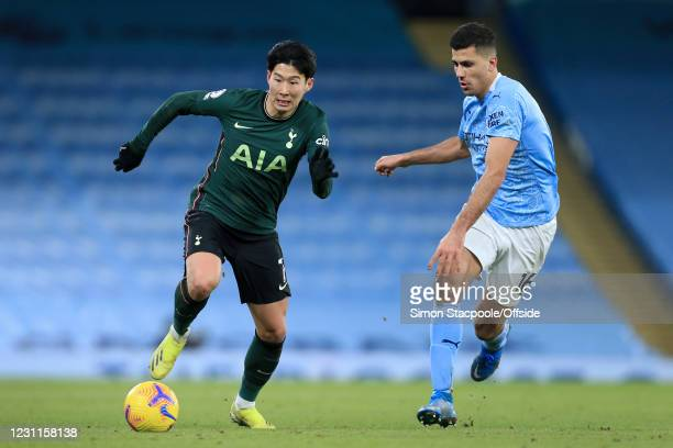 Son Heung-Min of Tottenham Hotspur battles with Rodri of Manchester City during the Premier League match between Manchester City and Tottenham...