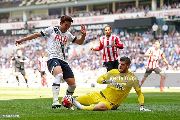Son HeungMin of Tottenham Hotspur beats Fraser Forster of Southampton on his way to scoring the opening goal during the Barclays Premier League match...