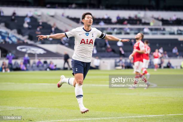 Son Heungmin of Tottenham Hotspur celebrates after scoring his team's first goal during the Premier League match between Tottenham Hotspur and...