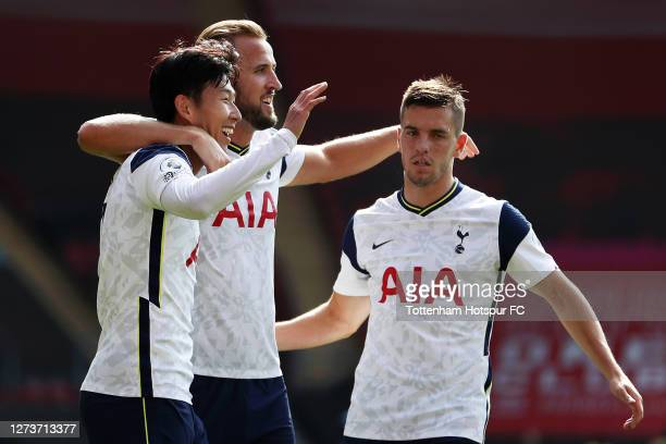 Son Heung-Min of Tottenham Hotspur celebrates after scoring his team's third goal with Harry Kane of Tottenham Hotspur and Giovani Lo Celso of...