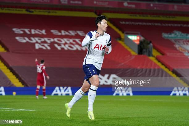 Son Heung-Min of Tottenham Hotspur celebrates after scoring their team's first goal during the Premier League match between Liverpool and Tottenham...